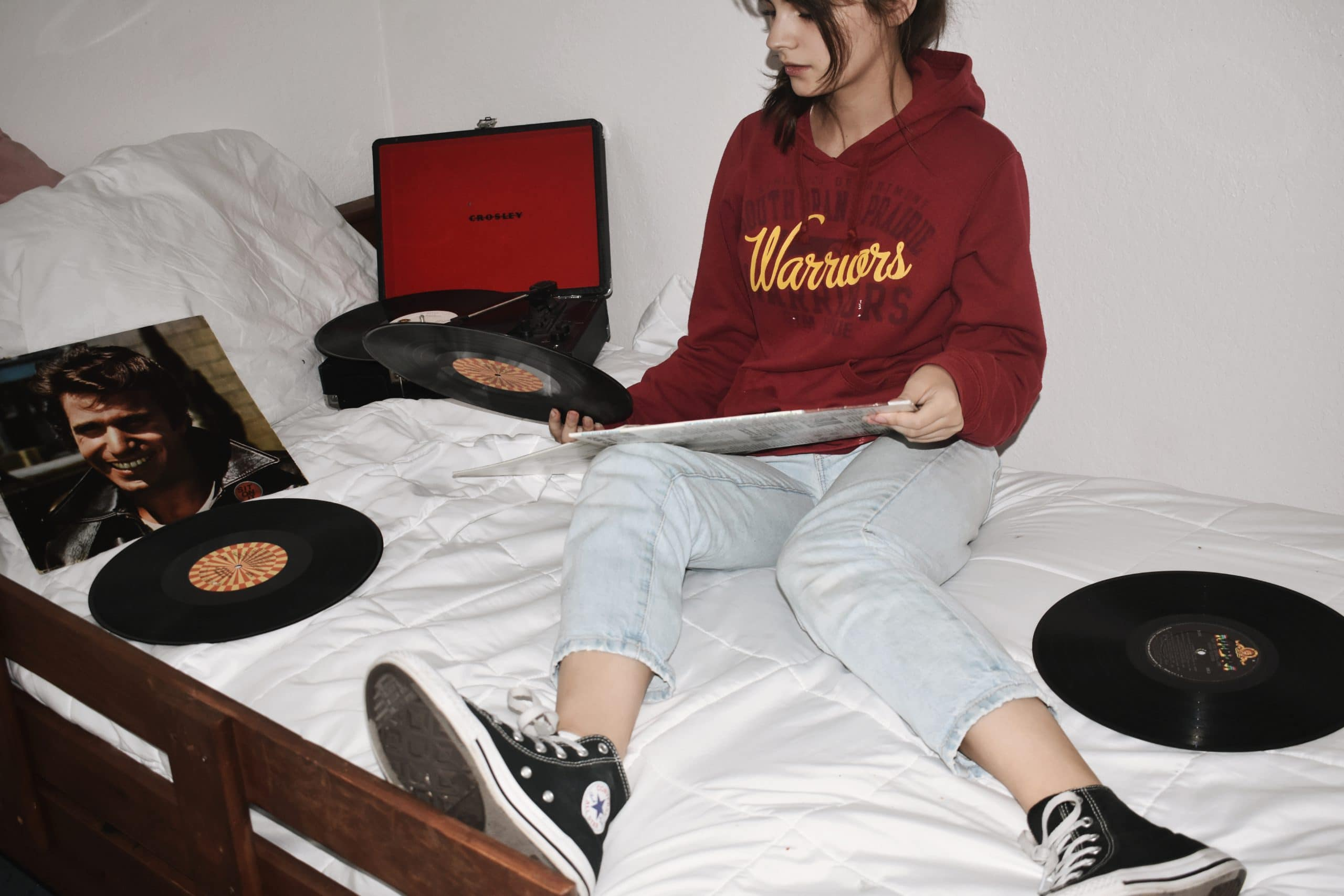 records player with girl on bed