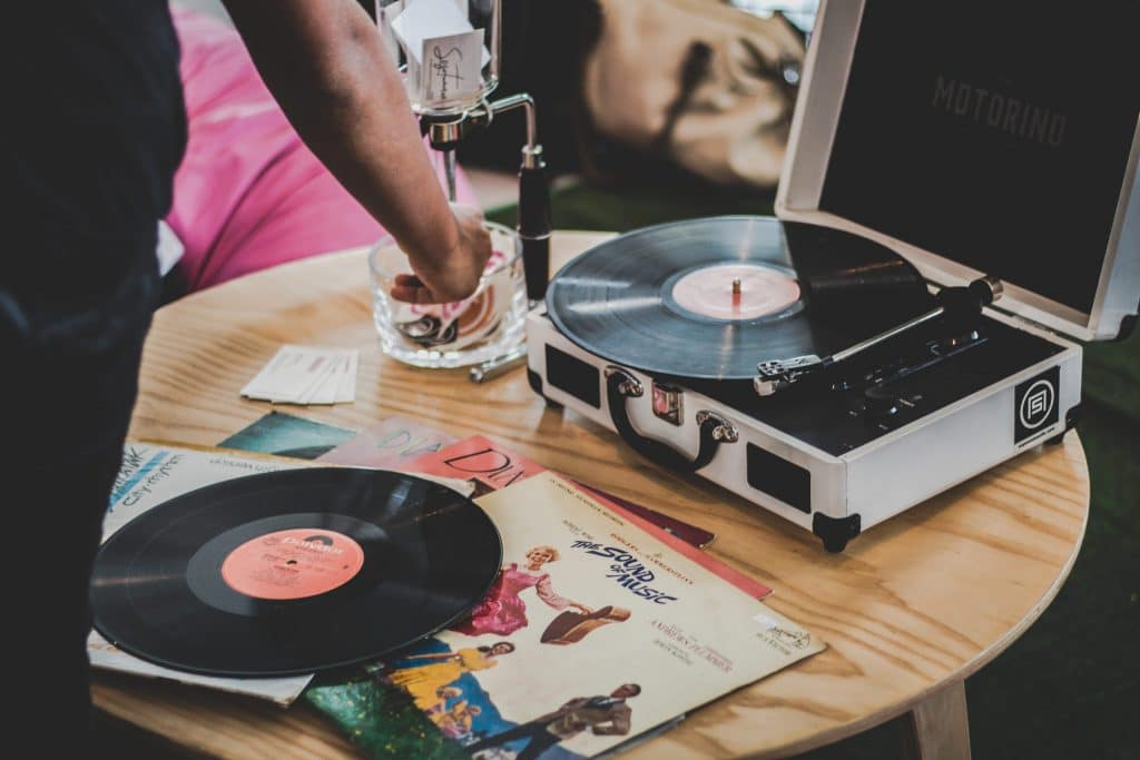 record player on table cleaning vinyl records with alcohol
